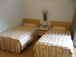 A 14 ping room with two single beds (you have the option of requesting one double bed).