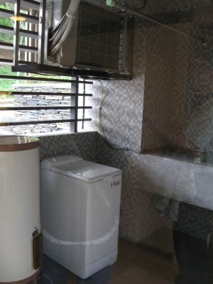 Balcony Area - you have to buy your own laundry machine or there are coin laundry machines.  Dry cleaning laundry service is also provided.