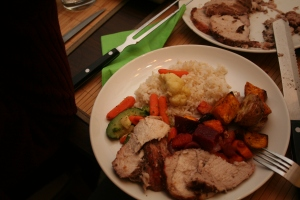 Roasted pork with carrots, sweet potato, beet.  Served with stir-fry vegetables and rice.